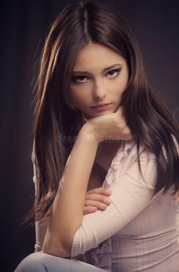 Sad girl on dark background stock photos