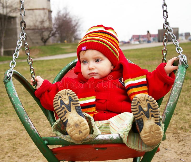 Download Sad girl drive on a swing stock photo. Image of life, front - 4769756