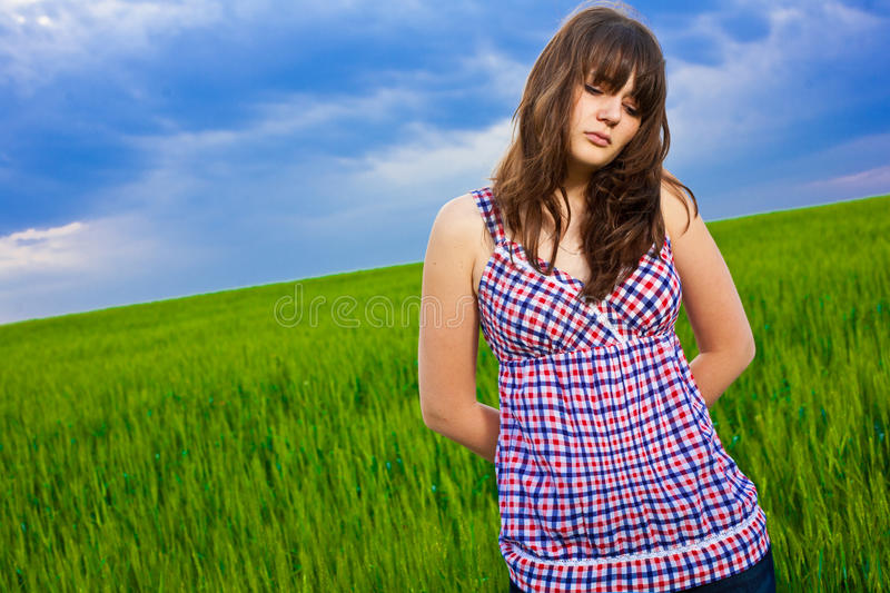 Sad girl in field royalty free stock photos