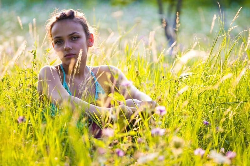 Sad girl in garden royalty free stock photos