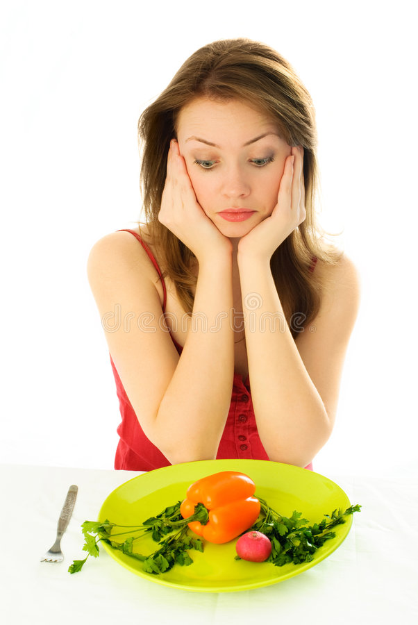 Sad girl keeping a diet royalty free stock photo