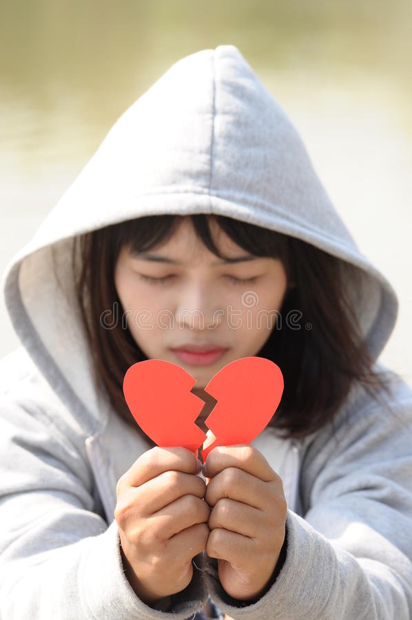 Sad Girl Praying to Reconcile from Red Broken Heart.  royalty free stock photos