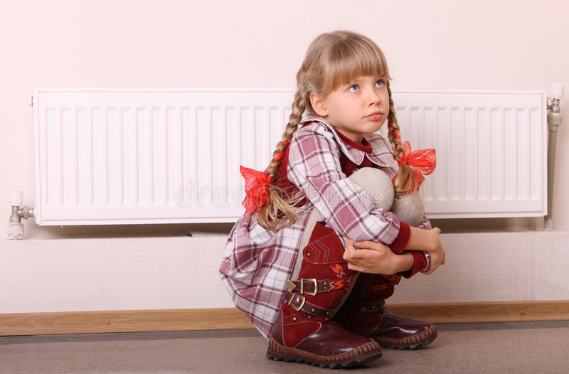 Download Sad Girl Sitting Near Heater. Children Problem. Royalty Free Stock Images - Image: 7725739