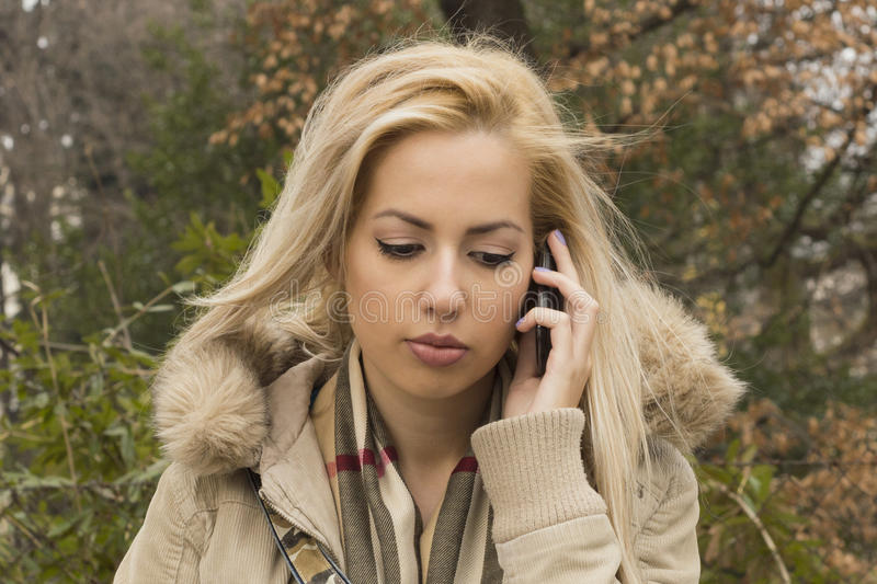 Sad Girl Talking On Mobile Phone royalty free stock images