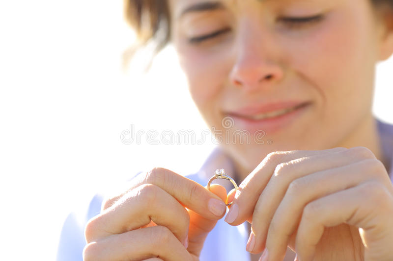 Sad girlfriend looking her engagement ring royalty free stock photo