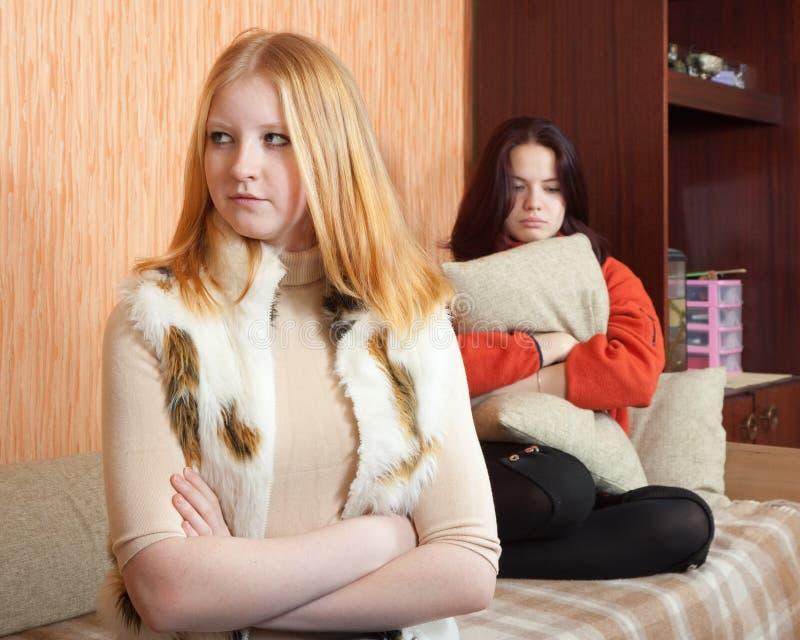 Sad girls having quarrel stock photo