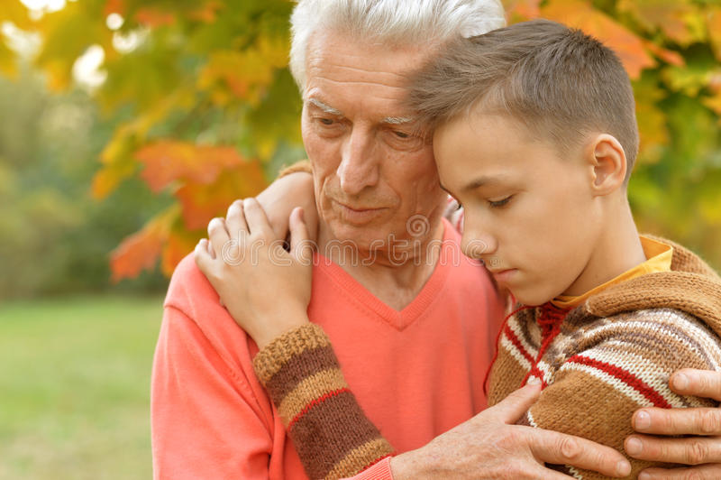 Sad grandfather and grandson royalty free stock image