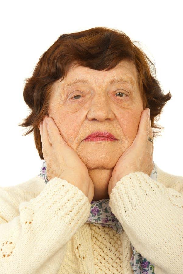 Sad grandma stock photo