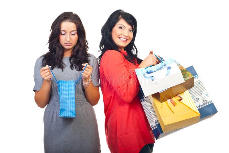 Sad and happy women at shopping royalty free stock photos