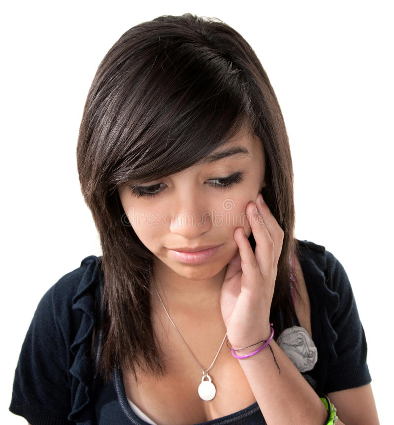 Sad Hispanic Girl. With hand on chin on white background stock photos