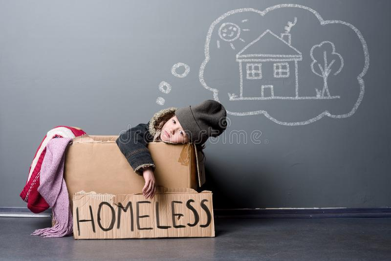 Sad homeless kid stock image