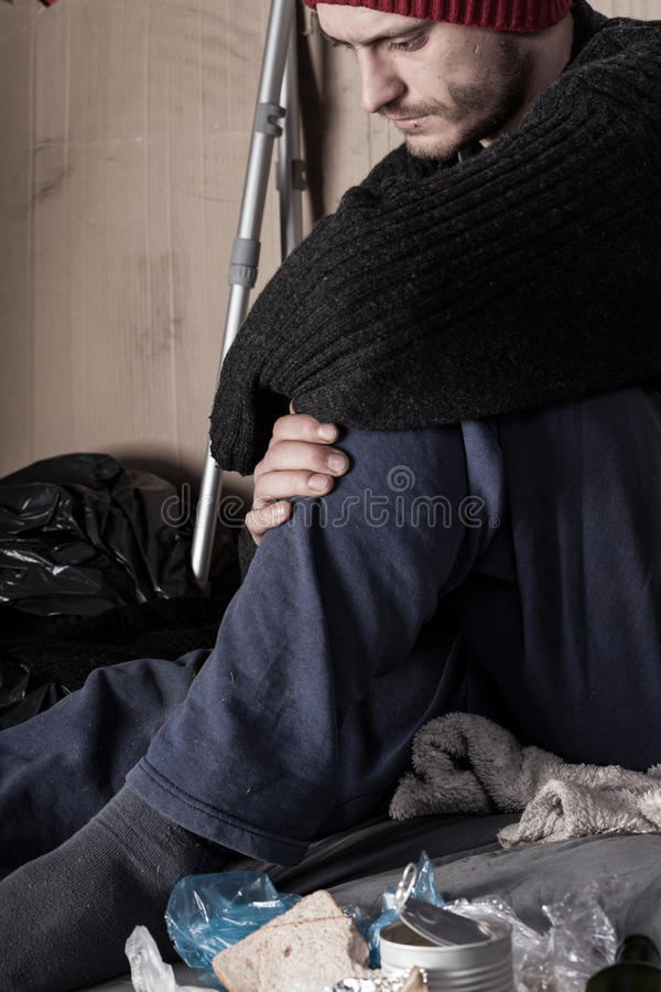 Sad homeless man on the street stock photography