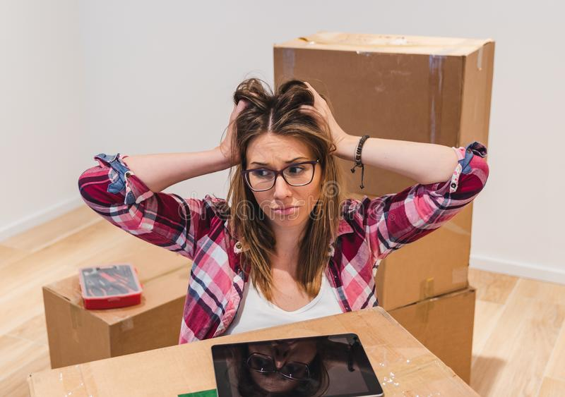Sad homeowner moving home after eviction royalty free stock photo