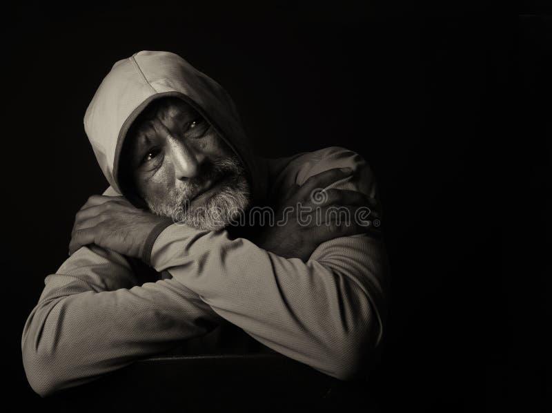 Sad Indian man. Image of a very Sad Indian man on Black stock photos