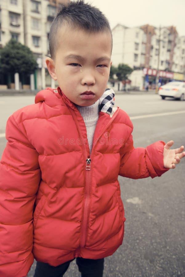 Sad kid stock image