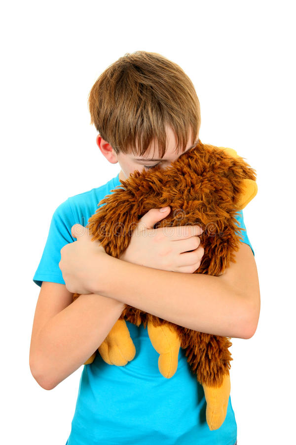 Sad Kid with Plush Toy stock photography