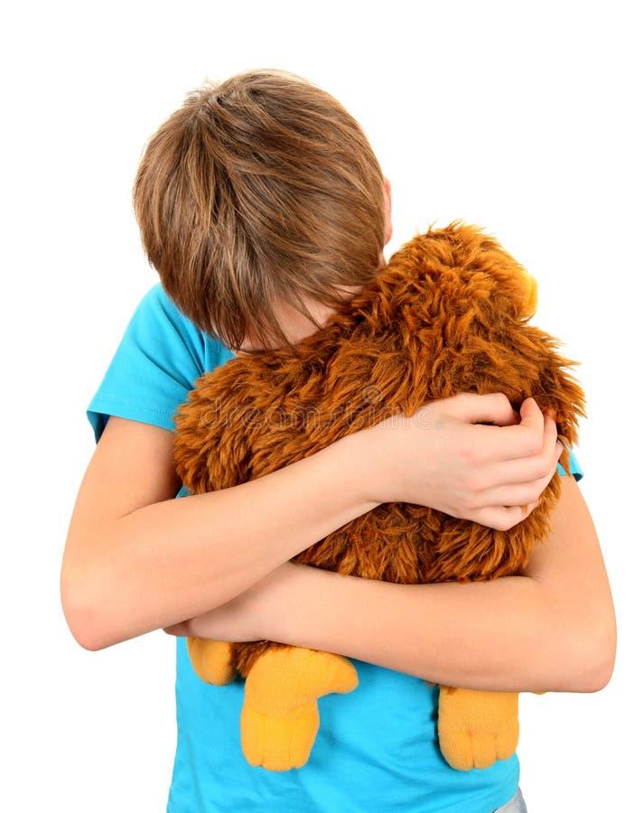 Sad Kid with Plush Toy stock images