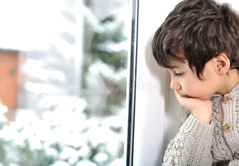 Download Sad Kid On Window Cannot Go Out Stock Image - Image: 24517521