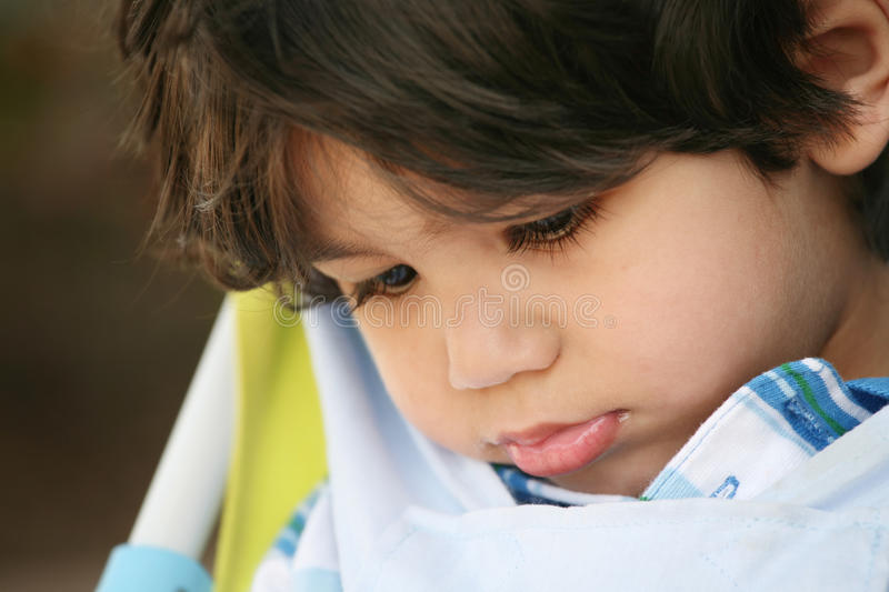 Download Sad Little Boy With Head Down Stock Photo - Image: 9572960