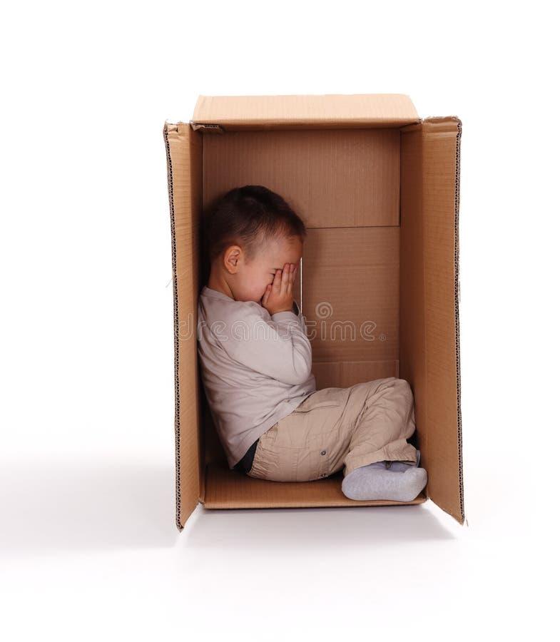 Download Sad Little Boy Hiding In Cardboard Box Stock Photo - Image: 22209856