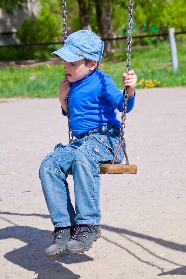 Free Sad Little Boy On A Swing Royalty Free Stock Image - 19613376