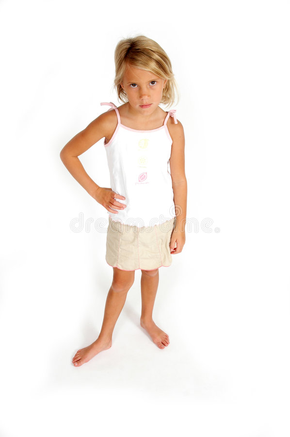 Sad Little Girl. Little girl stands with one hand on her hip and has sad expression. On white background. The ability to apprehend or understand; understanding royalty free stock photos