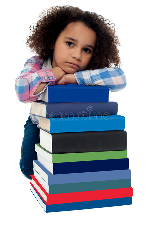 Download Sad Little Girl Bored Of Reading Stock Photos - Image: 31602913
