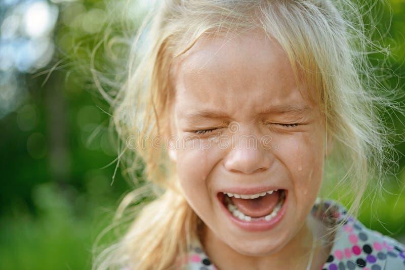 Sad little girl crying stock photos