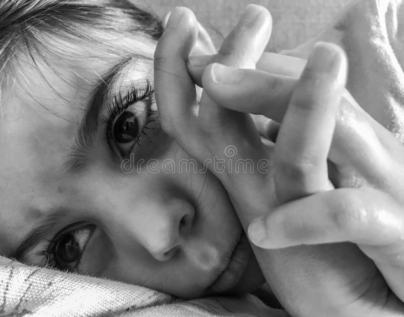 Sad little girl laying down royalty free stock images