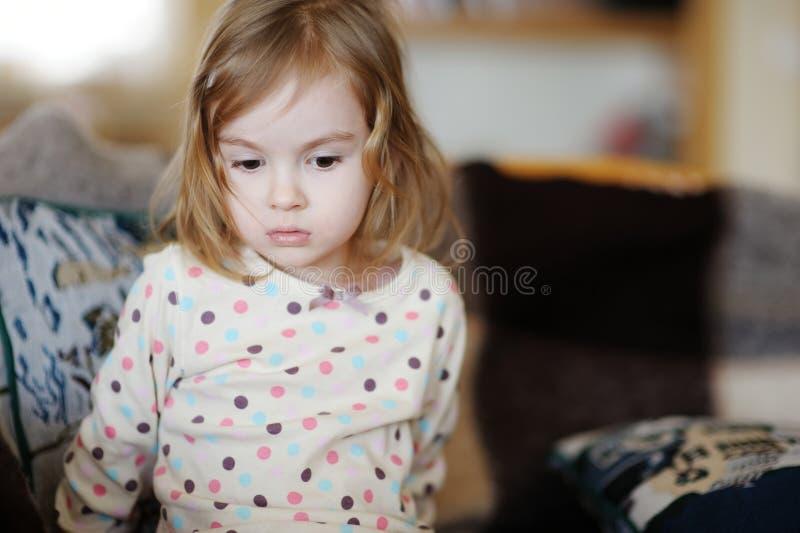 Sad little girl portrait stock image