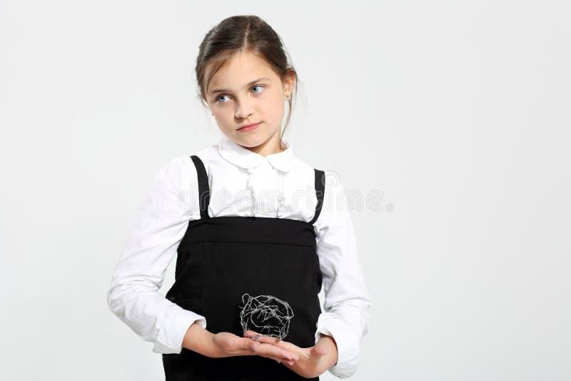 Sad little girl - school problems. stock images