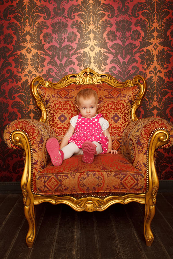 Download Sad Little Girl Sitting In Old Armchair Stock Photo - Image: 12729230