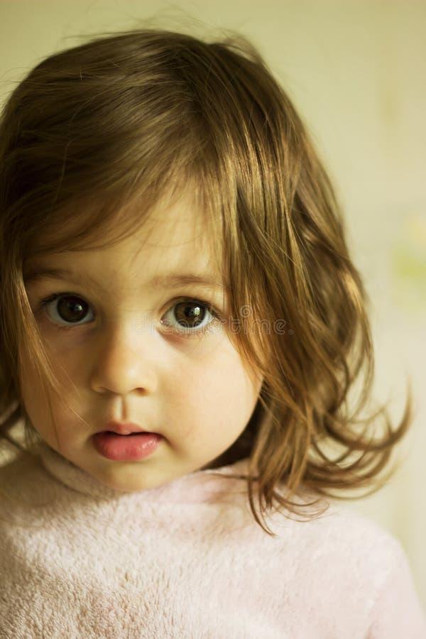 sad little girl thinking stock image