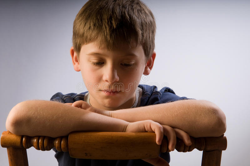 Sad little kid royalty free stock image