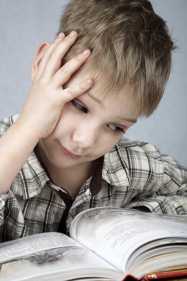 Sad little reader stock photo