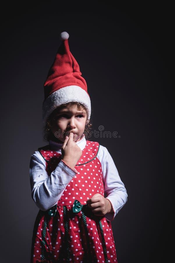 Sad little Santa. Portrait of little sad Santa,low key technique royalty free stock images