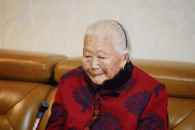 Sad and lonely Asian Chinese old woman 90s royalty free stock photography