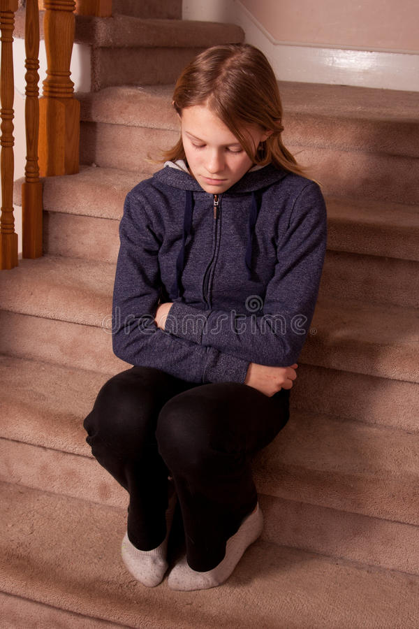Sad and lonely girl. Sat on the stairs at home royalty free stock photos