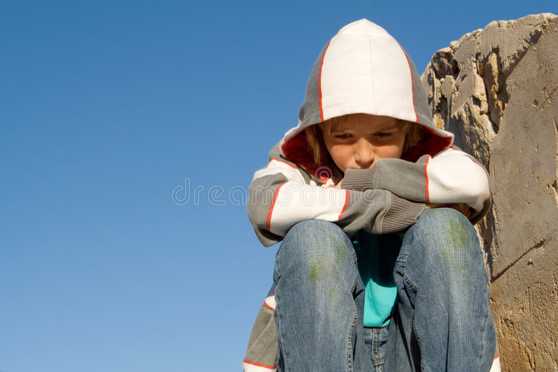 Sad lonely grieving child royalty free stock images