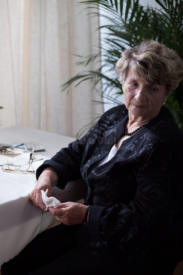 Sad lonely senior woman royalty free stock photos