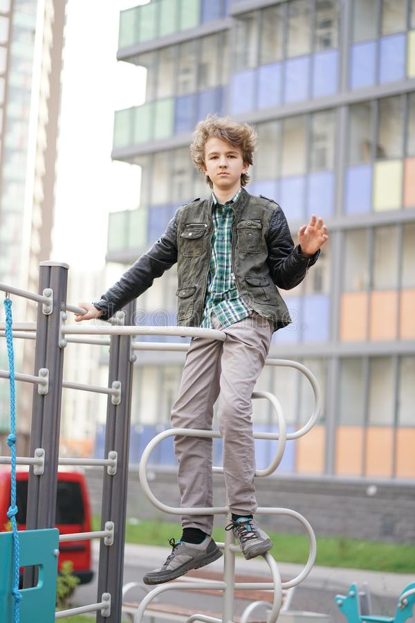 Sad lonely teenager outdoor on the Playground. the difficulties of adolescence in communication concept. Alone royalty free stock images