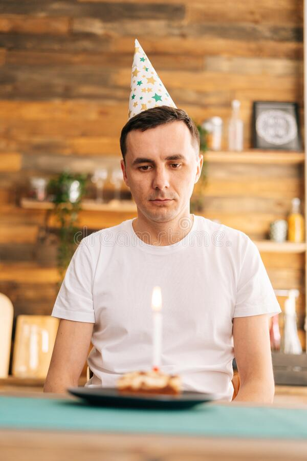 Happy Birthday Boggers. Sad-lonely-young-man-celebrating-birthday-alone-sitting-cake-festive-hat-looking-eyes-concept-178162725