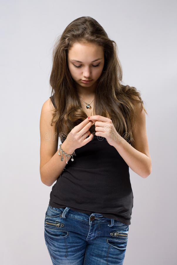 Download Sad Looking Young Brunette. Stock Image - Image: 23077223