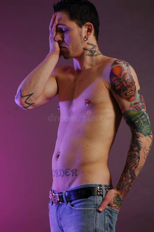 Sad Male With Tattoos Stock Photo