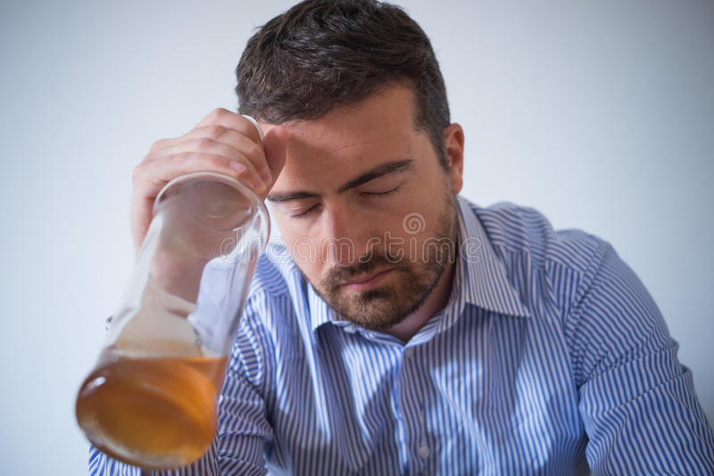 Sad man alcohol addicted feeling bad royalty free stock photo