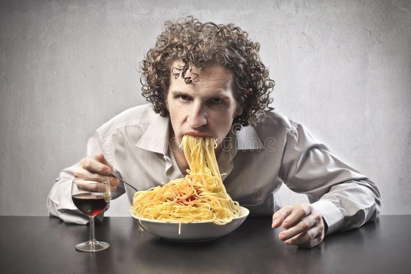 Sad Man Gorging. Of spaghetti with red tomato sauce stock photos