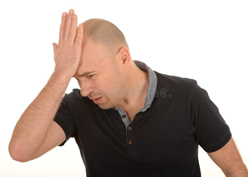 Sad man with hand on head. Side half body portrait of sad middle aged man with hand on bald head, white studio background stock image