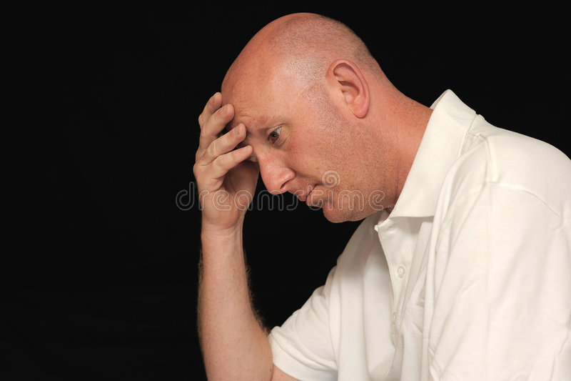 Sad man holding head royalty free stock image