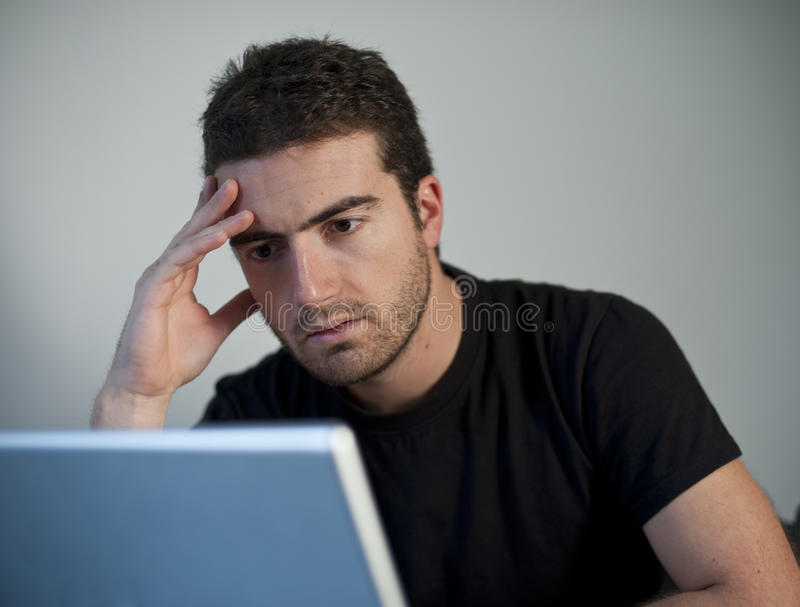 Sad man laptop stock photography
