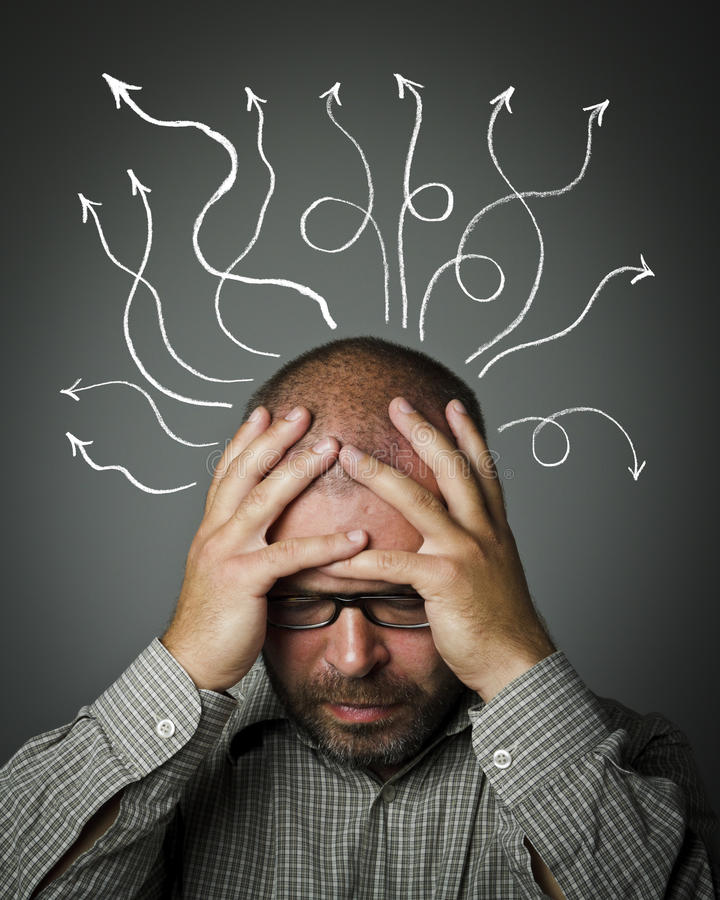 Sad man. Man in thoughts. Frustrated. Man solving a problem. Man suffering from inner chaos royalty free stock image